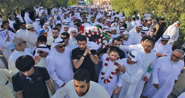 Mourners carry the body of one of the victims of the Al-Imam Al-Sadeq mosque bombing, during a mass funeral at Jaafari cemetery in Kuwait City on June 27, 2015. The interior ministry said in a statement that 26 people and the suicide bomber were killed and 227 others were wounded in one of the country's worst bombings and its first ever on a mosque. AFP PHOTO / YASSER AL-ZAYYAT
