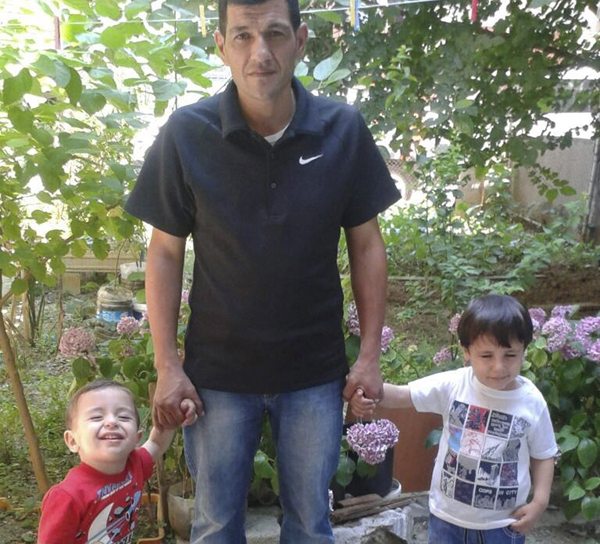 Abdullah Kurdi (C) poses with his sons Aylan (L) and Galip (R) in an undated photo provided by the Kurdi family. Abdullah Kurdi, distraught father of two Syrian toddlers who drowned with their mother and several other migrants as they tried to reach Greece identified their bodies on Thursday and prepared to take them back to their home town of Kobani. Aylan, 3, his brother, Galip, 5, and mother, Rehan, 35, were among 12 people, including other children, who died after two boats capsized while trying to reach the Greek island of Kos. REUTERS/Kurdi family/Handout via ReutersATTENTION EDITORS - THIS PICTURE WAS PROVIDED BY A THIRD PARTY. REUTERS IS UNABLE TO INDEPENDENTLY VERIFY THE AUTHENTICITY, CONTENT, LOCATION OR DATE OF THIS IMAGE. NO SALES. NO ARCHIVES. FOR EDITORIAL USE ONLY. NOT FOR SALE FOR MARKETING OR ADVERTISING CAMPAIGNS. THIS PICTURE IS DISTRIBUTED EXACTLY AS RECEIVED BY REUTERS, AS A SERVICE TO CLIENTS. TPX IMAGES OF THE DAY.