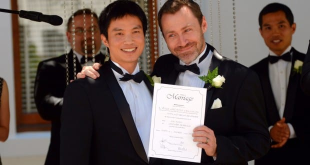 Marriage Equality director Ivan Hinton and Chris Tench display their marriage certificate in Canberra, Saturday, Dec.7, 2013. The Australian Capital Territory equal marriage legislation came in to force at midnight allowing same sex marriages for the first time in Australia. (AAPIMAGE/Alan Porritt) NO ARCHIVING