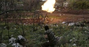 A rebel fighter of 'Ahrar Jableh' brigade launches a mortar in the Jabal al-Akrad area in Syria's northwestern Latakia province April 28, 2015. The rebels are carrying offensives in an attempt to cut off supply routes of forces loyal to Syria's President Bashar al-Assad who are stationed in al-Ghab plain in the Hama countryside. Picture taken April 28, 2015. REUTERS/Khalil Ashawi